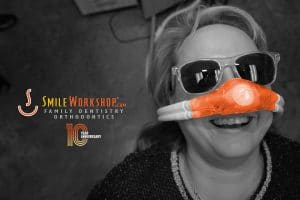 Woman laughing from nitrous oxide and Smile Workshop logo